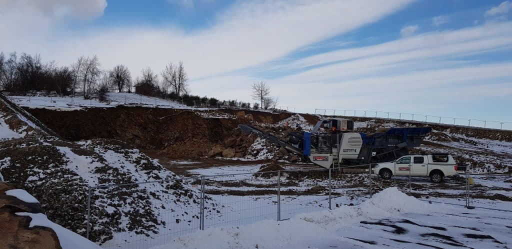 Baustelle im Schnee - CO2 sparen